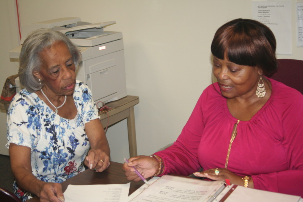 APPRISE counselor speaking with an older woman about health insurance