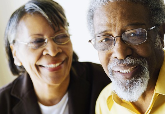 An African-American woman and man, smiliing