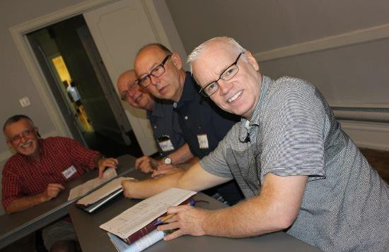 "Members o the ""Mornings Out"" advisory group (from left) Mark Kleinwichs, Mark Sandburg, John Murphy and Ed Miller, meet to discuss programming for the  fall and winter months. (Photo courtesy of William Way LGBT Community Center)"