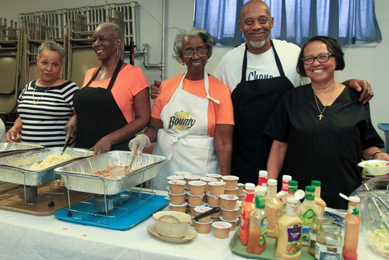 Pictured above (from left) are Margaret Custalow, Tamara Jones, Catherine Gaines, William(Bill) Manson and Rev. Nancy Jackson help to serve a meal to people in need at Zion A.M.E. Church in South Philadelphia. (Photo by Paola Nogueras)