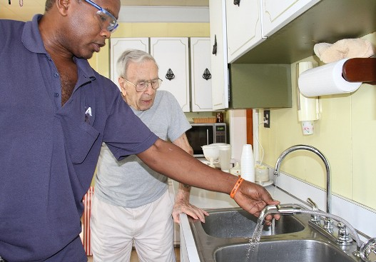 Minor repairs, such as repairing leaky faucets or installing railings, can make a big difference to an older adult who is living alone. (Photo by Evangelina Iavarone)