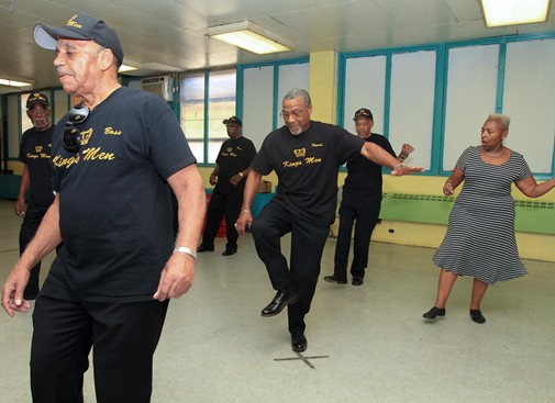"""""""The King's Men"""" line dancers practice in class at the Martin Luther King Older Adult Center in North Philadelphia. (Photo by Paula Nogueras)"""