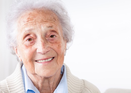 Older woman with white hair, smiling