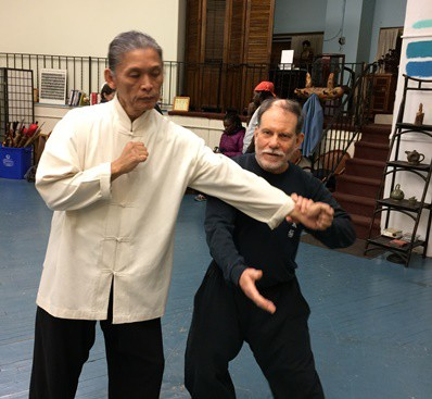 Martial arts teacher (left) and student