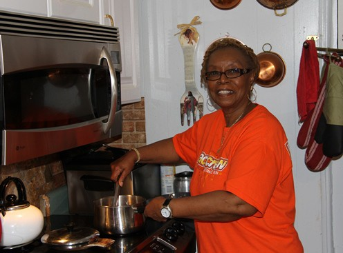 Domiciliary (Dom) Care provider Dolores Luckey prepares a meal. (Photo by Alicia Colombo)