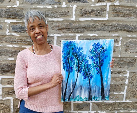 Writer and nascent artist Constance Garcia-Barrio poses with the painting she created in an evening at a Painting with a Twist studio. (Photo by Mike Finnell)