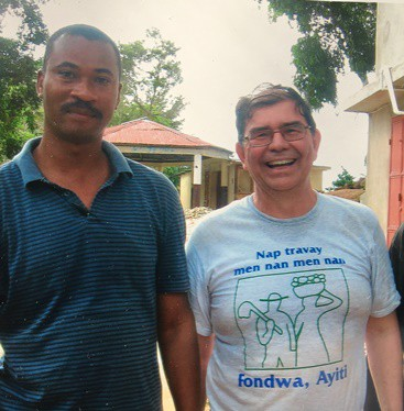 Ray Torres (right) worked with Haitian leader Herault Beauvais as part of his volunteer efforts in Fondwa, Haiti. (Photo courtesy of Ray Torres)