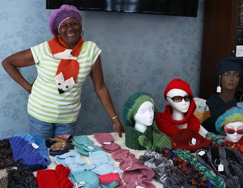 "The Center at Journey's Way's (JW's) annual ""Christmas in July"" sale features items made by JW members. Proceeds benefit the center. (Photo by Frank Burd)"