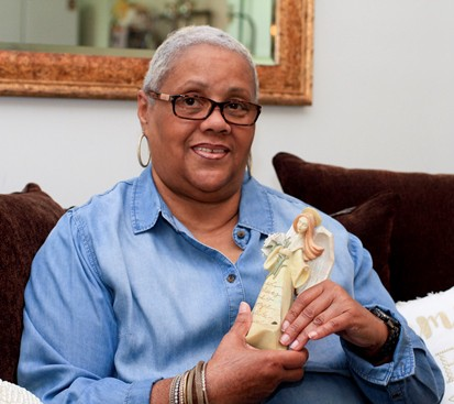 'DomCare' provider Sylvia Robinson-Hite holds an angel given to her by a former 'Dom Care' resident in her home. (Photo by Paola Nogueras)