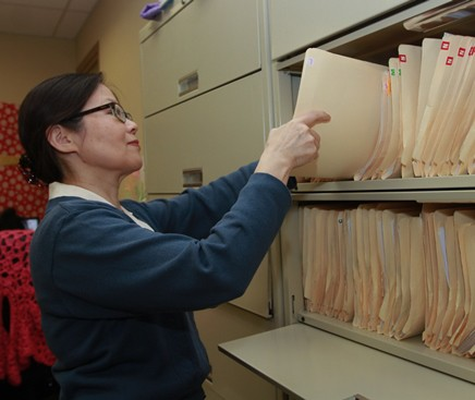 Chinese émigré Xi Hu was hired as a file clerk at at Penn Asian Senior Services Inc. (PASSi) as a result of her training with the Senior Community Service Employment Program (SCSEP). (Photo by Paola Nogueras)