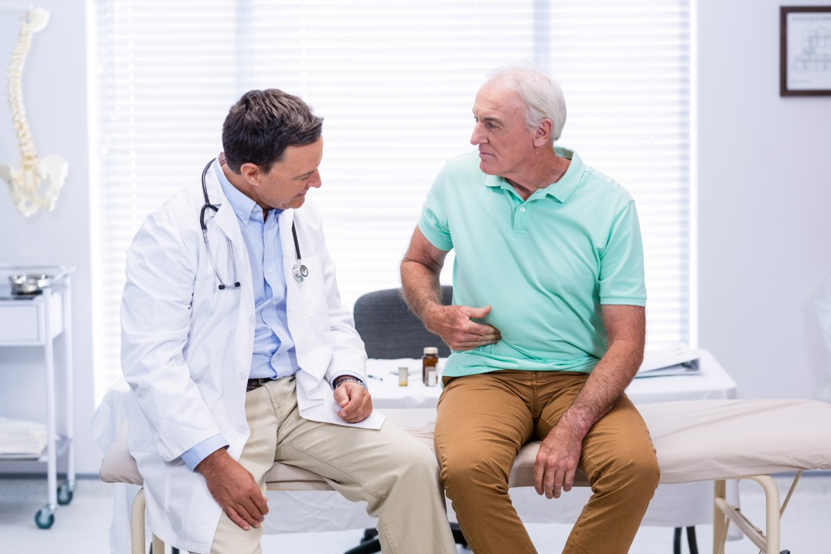Man-doctor-Stomach_iStock-653833054