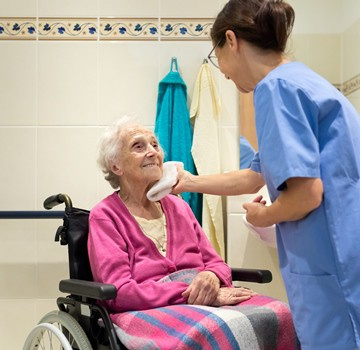 CROPPEDPersonal-Care-Aide-Wheelchair_Woman_iStock-613314366