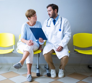 CROPPEDDoctor-Woman-Patient-Discussing-Chart_shutterstock_584323645