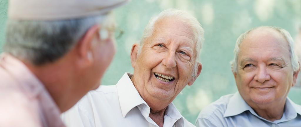 Three Caucasian elderly Men Talking