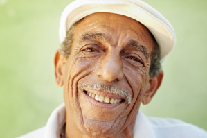 Man with hat smiling