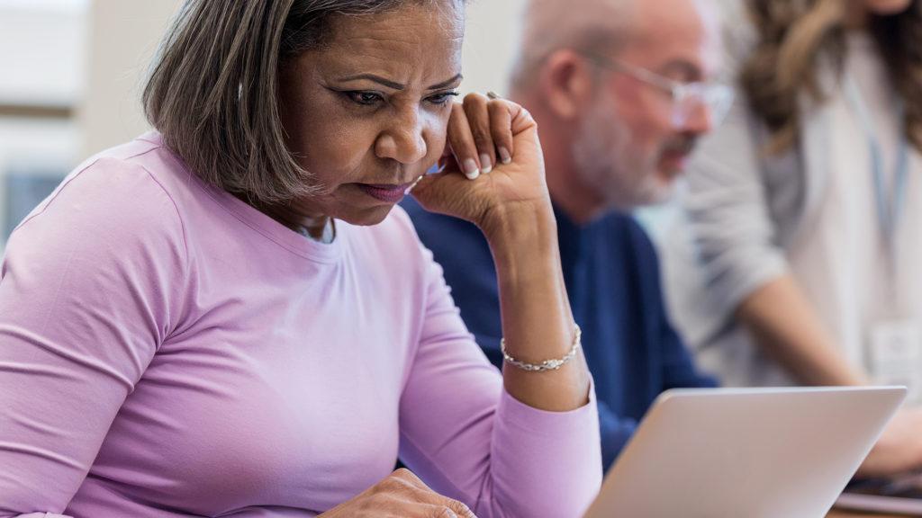 Woman Focused on Laptop